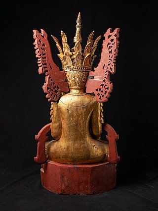 Large old wooden crowned Buddha