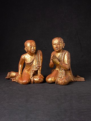 Pair of antique Burmese monk statues
