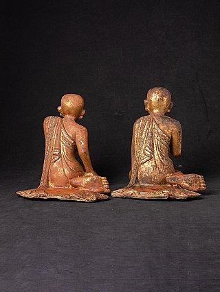 Pair of antique Burmese monk statues