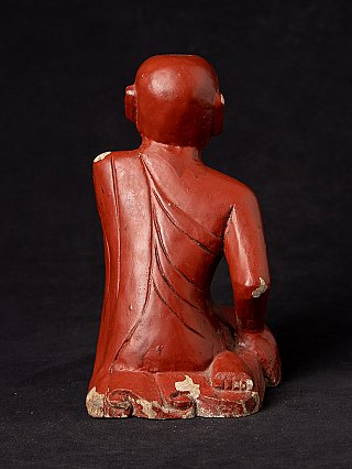 Old wooden Burmese monk statue