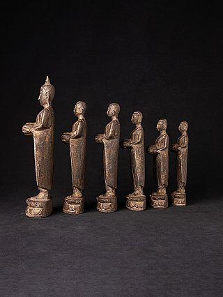 Old pair of Burmese Buddha with monk statues