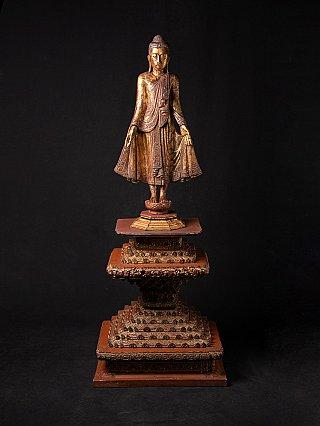 Antique standing Mandalay Buddha on throne