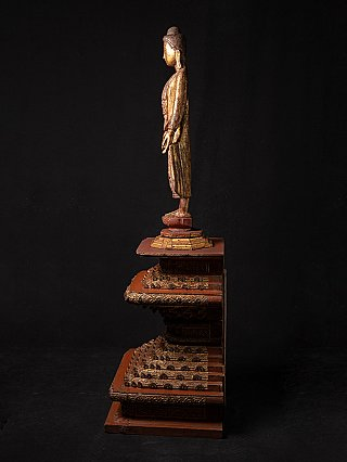 Antique standing Mandalay Buddha on throne