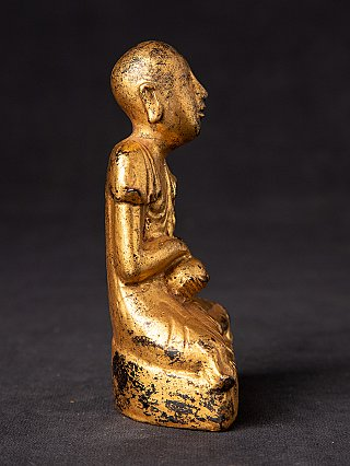 Antique Burmese monk statue