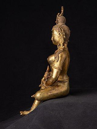 Old bronze Nepali Basundara statue