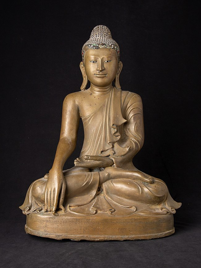 Beautiful antique bronze Mandalay Buddha statue
