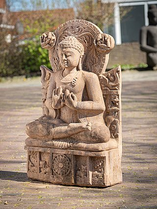 Old sandstone Indian Buddha statue