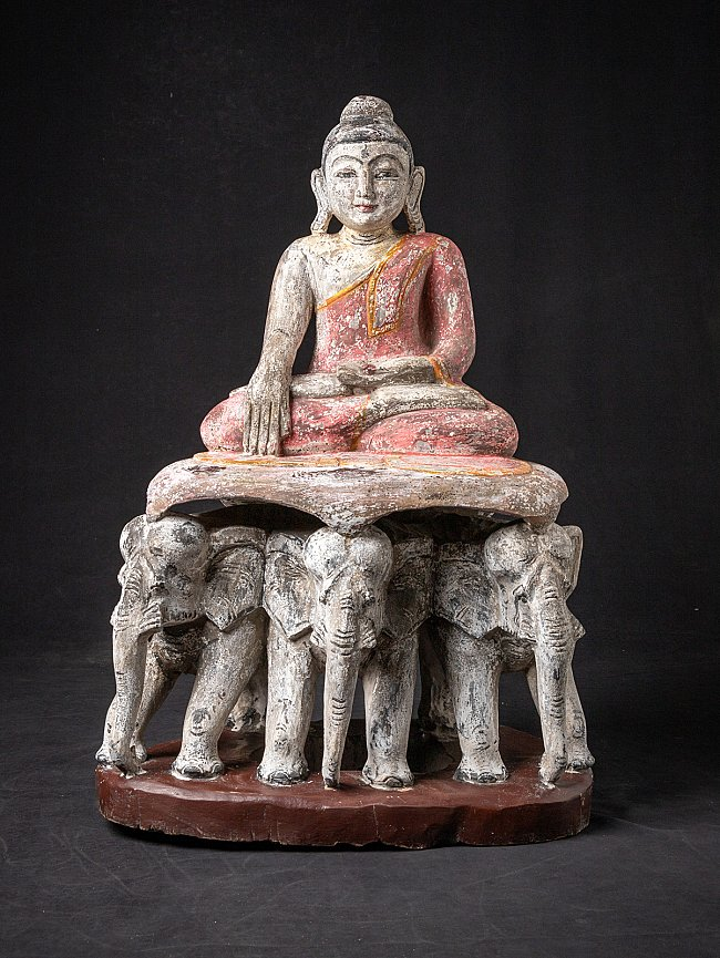 Old Burmese Buddha on elephant throne
