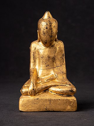 Antique Buddha statue without a face