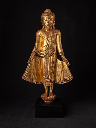 Antique standing wooden Mandalay Buddha