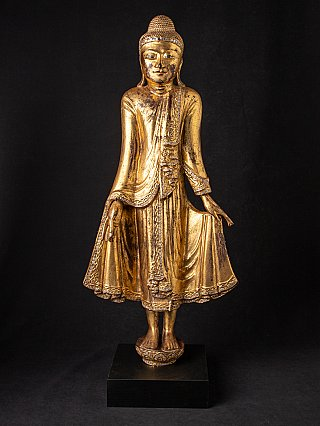 Antique wooden standing Mandalay Buddha