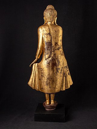 Antique wooden standing Mandalay Buddha
