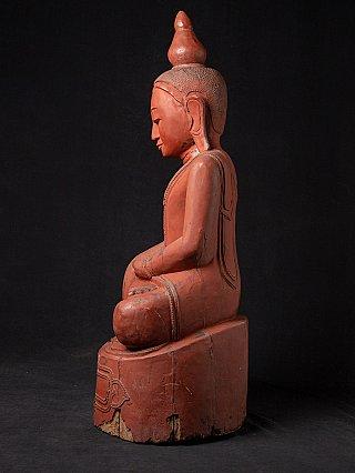 Old teakwooden Buddha statue