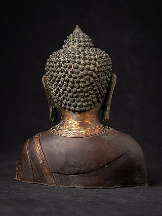 Old bronze Nepali Buddha head