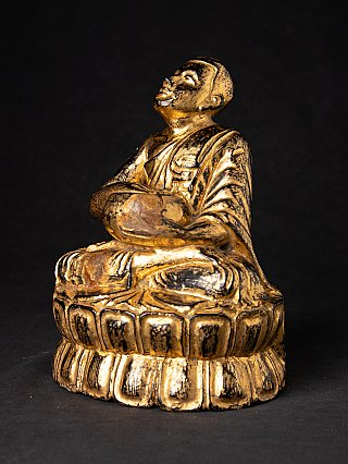 Antique wooden Burmese Monk statue