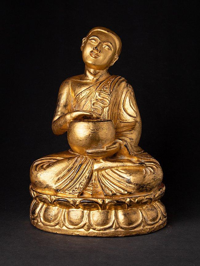 Antique Burmese wooden monk statue