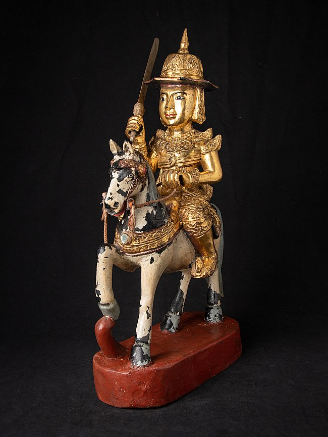 Antique wooden Burmese Nat statue on horse