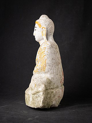 Old marble Burmese Mandalay Buddha statue