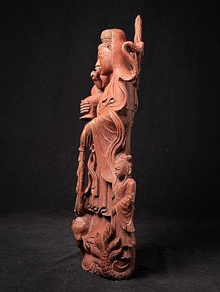 Old Burmese wooden Guan Yin statue