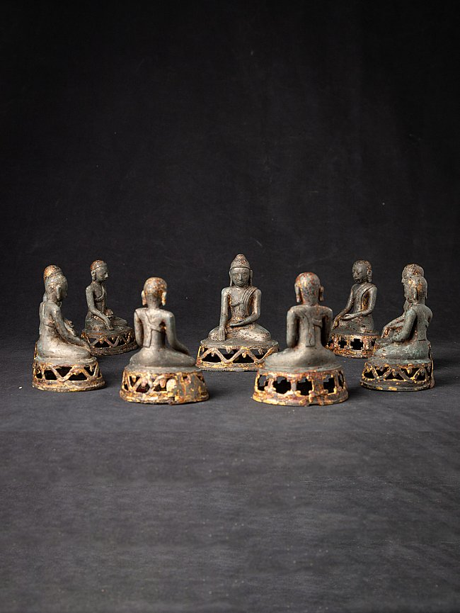 Antique set of Buddha with monk statues