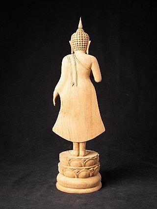 Newly made teak wooden Buddha statue