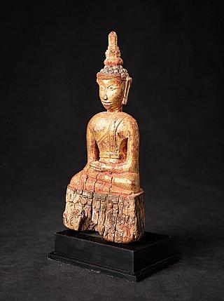 Antike holzerne Thailandische Buddhafigur