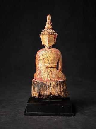 Antique wooden Thai Buddha statue