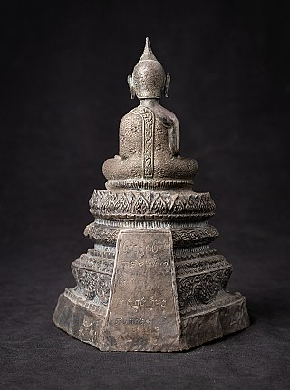 Antique silver Buddha statue