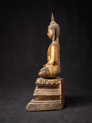 Antique wooden Thai Buddha statue