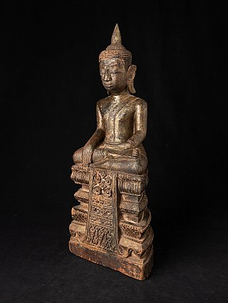 Antique wooden Thai Ayutthaya Buddha statue