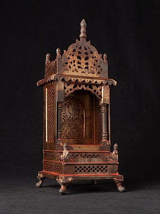 Old metal Buddhist shrine