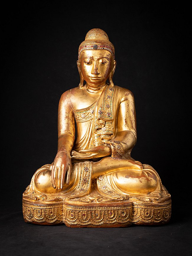 Antique wooden Mandalay Buddha statue