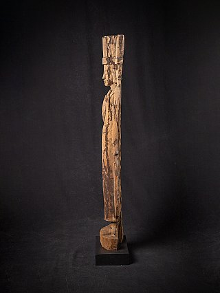 Antique standing wooden crowned Buddha statue