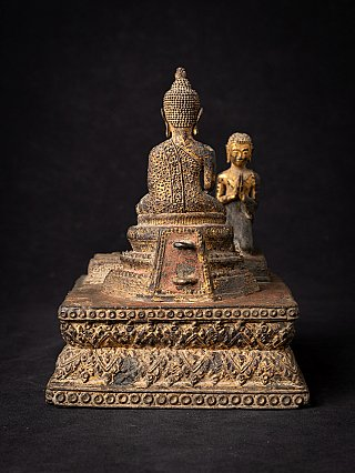 Antique bronze Thai Buddha with monk statue
