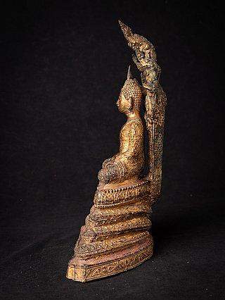 Antique Thai Buddha on Naga snake