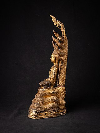 Antique bronze Thai Buddha on Naga snake