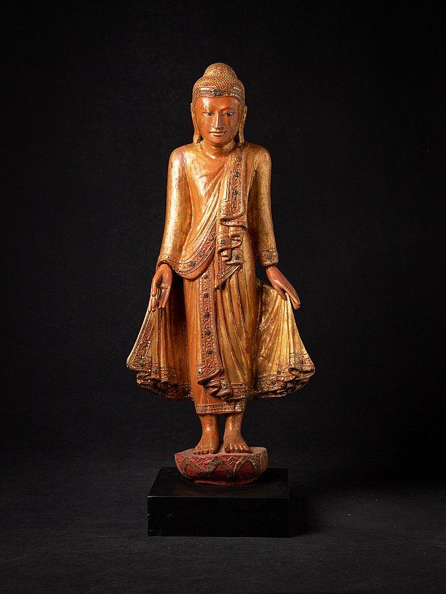 Antike holzerne Mandalay Buddhafigur