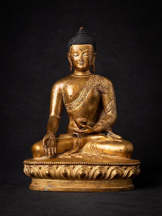 Old bronze Nepali gilded Buddha statue