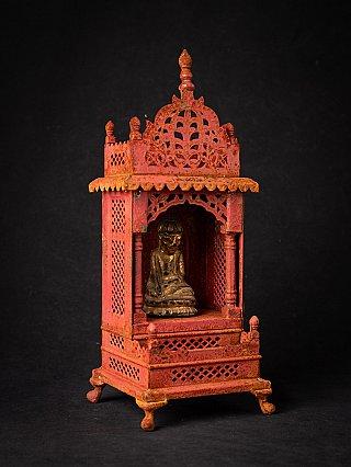 Old metal shrine with antique Burmese Buddha