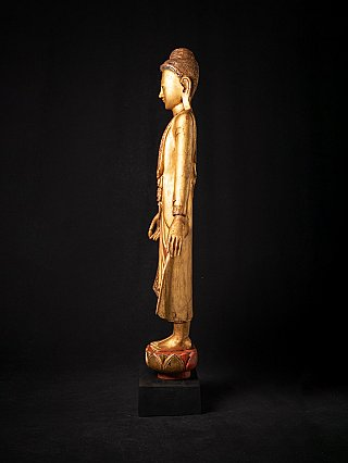 Antique wooden standing Mandalay Buddha statue