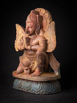 Old sandstone Garuda statue