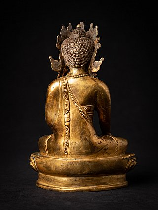 Old bronze Nepali crowned Buddha statue