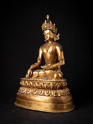 Old bronze Nepali crowned Buddha statue