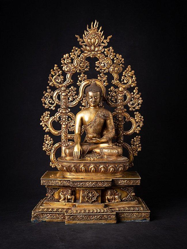 Old bronze Nepali Buddha on throne