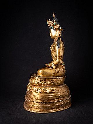 Old bronze Nepali crowned Buddha