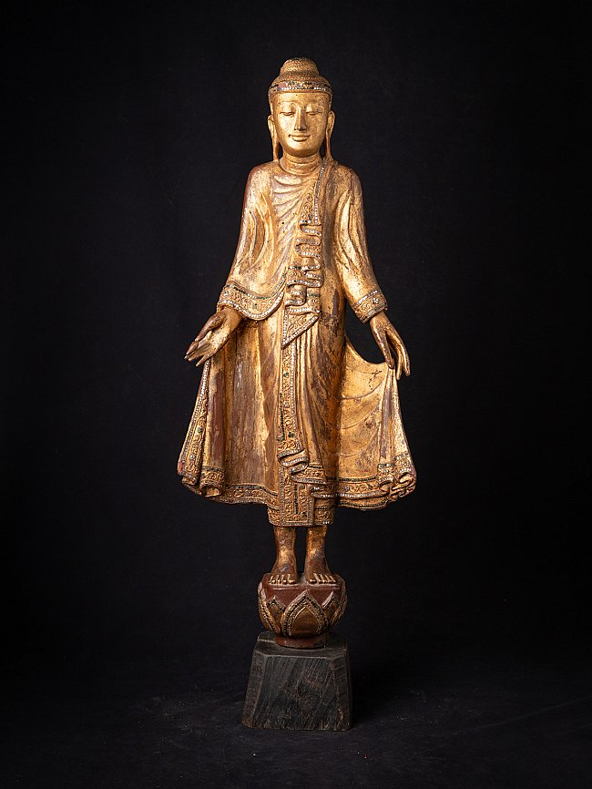Old wooden Burmese Mandalay Buddha statue