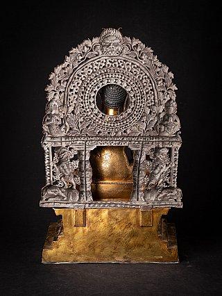 Old bronze Nepali Medicine Buddha on throne
