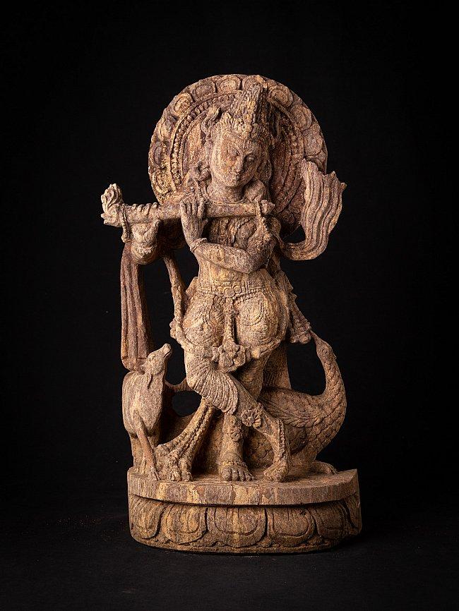 Old sandstone Krishna statue