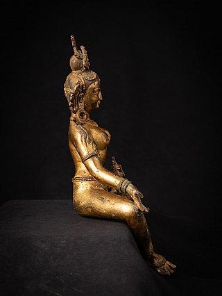 Old bronze Nepali Vasudhara statue