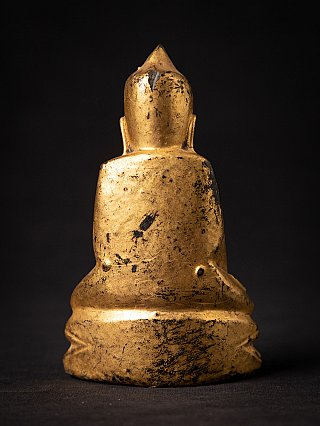 Antique Buddha statue without face